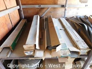 (1) Middle Shelf Bulk Lot with (20+) Boxes of Molded Rubber Wall Bases