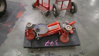 (1) Husky 3 Ton Floor Jack and (2) Stationary Jacks