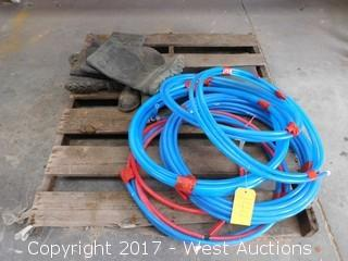 Pallet with Plastic Tubing and Boots