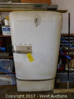 Vintage Norge Refrigerator with Welding Sticks and Supplies