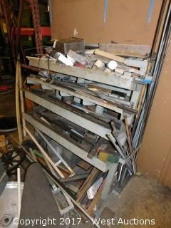 Bulk Lot of Punch Dies, Aluminium Raw Material, and Steel Thread on a Rack