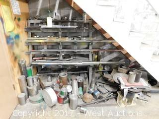 Bulk Lot of Punch Dies, Aluminium Raw Material, Steel Thread, and Steel Stock on a Rack