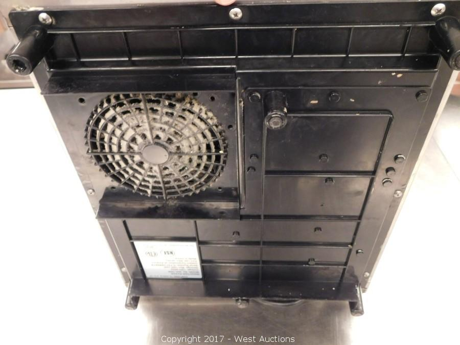 Table Top Induction Cooker ~ West auctions auction complete sellout of famed