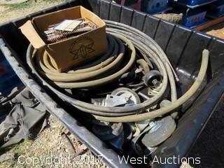 Wheelbarrow of Various Tires and Hoses