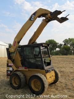 CAT 242 Skid Steer