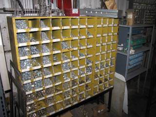 Nut and Bolt Rack W/ Contents and Metal Rack W/ Parts Storage Boxes W / Contents