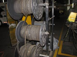 Metal Hose Reel Rack W/ Hoses and Misc Hoses on Wall