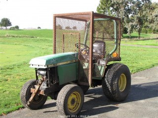 John Deere 955 Tractor with Protective Metal Cage