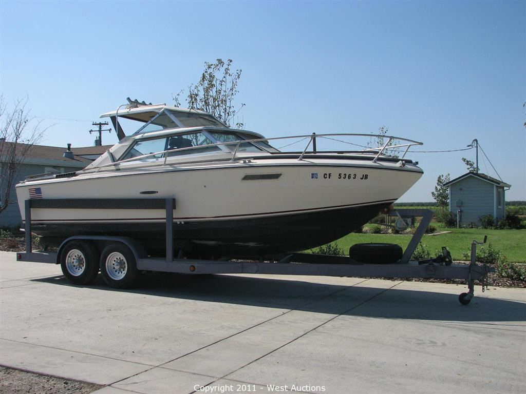 West Auctions - Auction: Trucks, Boat, Construction and Ag