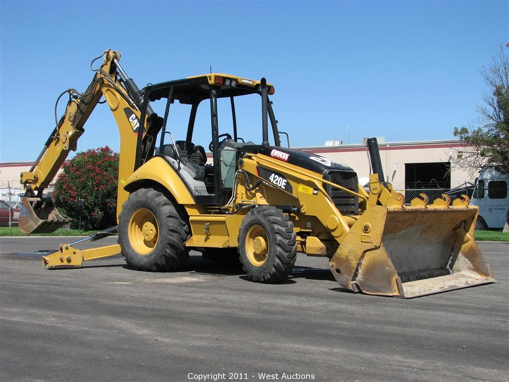 West Auctions Auction Two Caterpillar 420e Backhoe Loaders Box Trailer With Office And 26 Road Systems Trailer Item Caterpillar 420e Backhoe Loader
