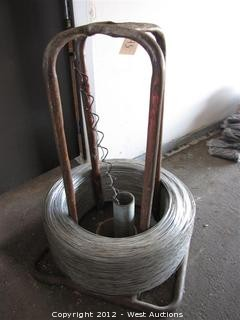 Spool of Thin Gauge Fence Wire on Wire Feed Stand