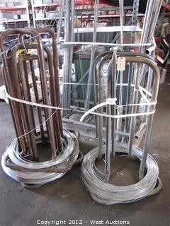 (4) Partial Wire Spools and (4) Wire Feed Stands