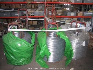(8) Spools of Galvanized Weaving Wire with Wire Feed Stands