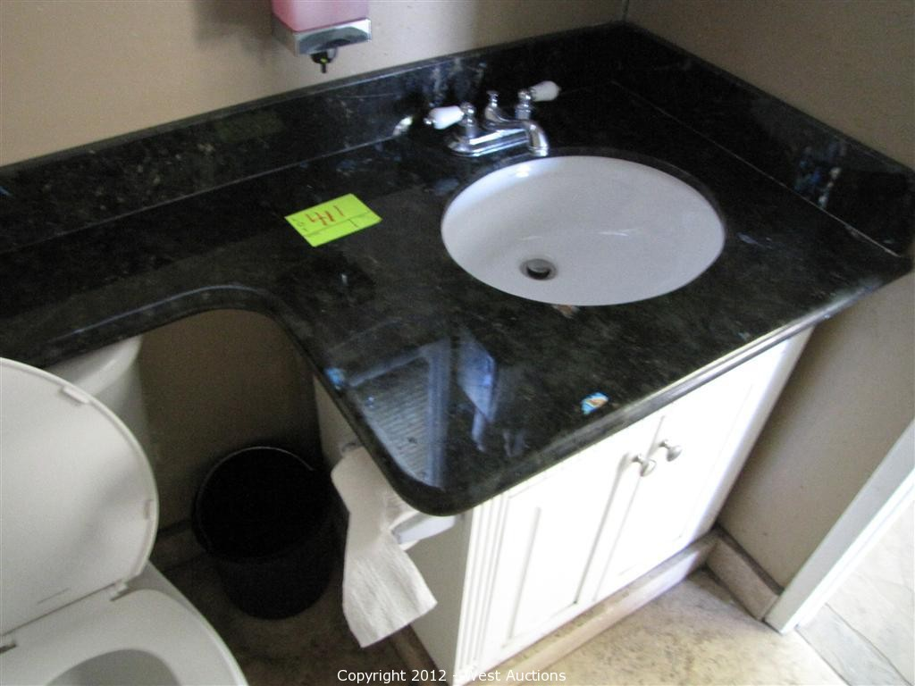 West Auctions Auction Granite And Marble Company Liquidation Item Bathroom Vanity With Sink And Faucet