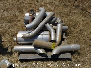 Assorted Mufflers and Truck Exhaust Pipes