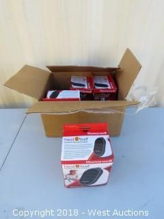 Box Of (4) Honeywell Heat Bud Personal Heaters