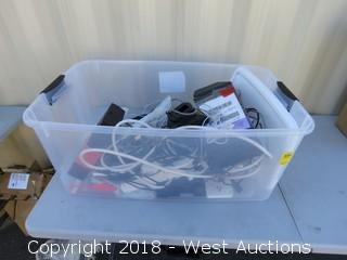 Power Strips and Drone Accessories in Plastic Bin
