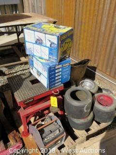 Pallet of (6) Wheels, Battery, Wheel Chocks and Jack