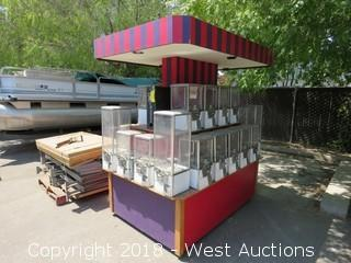 (28) Coin-Operated Vending Machines on Carnival Stand