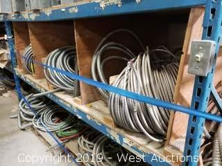 (2) Shelves of 1000' Rolls of Flexible Cable Enclosures