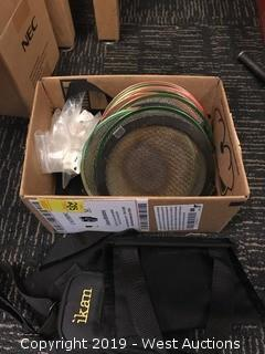 Box Of Lens Covers And Other Parts