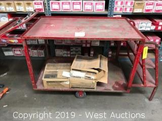 Metal Rolling Cart With Stairs And Attached Clipboards.