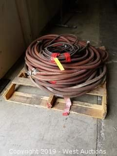 (3) Coils of Heavy Air Hoses and (1) Heavy Extension Cord
