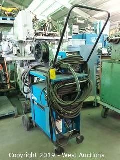 Miller CP-300 DC Arc Welder With Wire Feeder, Cart And Accessories.
