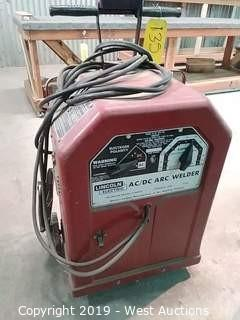 Lincoln Electric AC/DC Arc Welder with Welding Helmet and Supplies