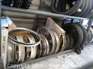 Shelf of Tireless Motorcycle Wheels and Assorted Motorcycle Tires