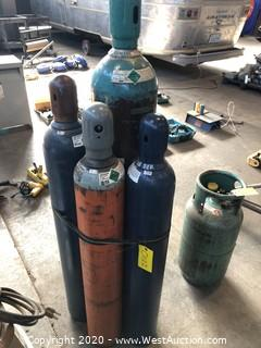 (4) Welding Tanks