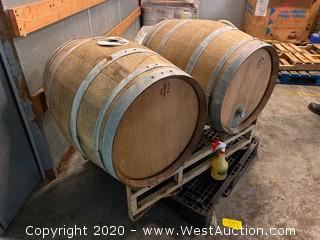 (2) Wood Distilling Barrels on Barrel Rack