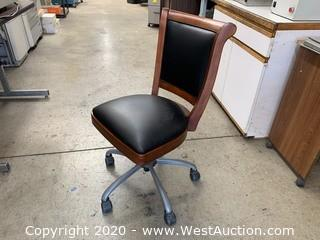 Desk Chair with Brown Wood Trim and Black Leather Upholstry
