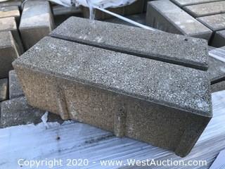 "Ackerstone Aqua Line Permeable Paver. 4"" x 12"" x 100mm Thick. Mesa Buff Through-mix Color."