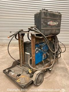 Miller XMT 304 Series DC Inverter Arc Welder with Suitcase Xtreme 12VS Wire Feeder and Cart