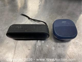 (1) Bose and (1) Tribit Portable Speaker