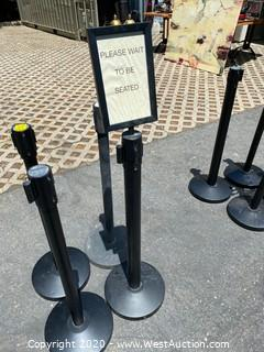 (4) Stanchions with Retractable Ribbons and (1) Sign-Holder Attachment