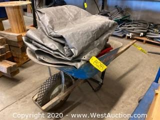Wheelbarrow with Tarp, Hoses, and More