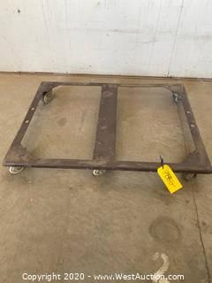 Metal frame dolly on casters