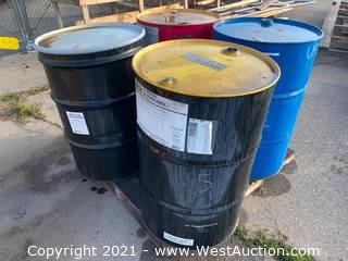 (4) Assorted 55 Gallon Oil Drums