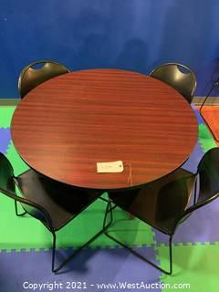 "Wood Round 48"" Table and (4) Black Sliding Chairs"