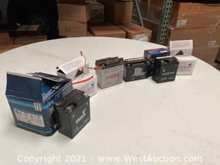 (4) Motorcycle Batteries And (2) Battery Filler Tanks