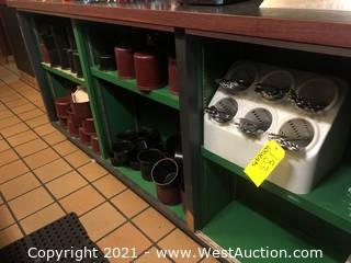 Contents Of Shelves Including Salad Bar Containers And Silverware