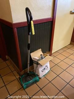 (2) Bissel BigGreen Commercial Rolling Vacuums