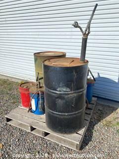 Pallet Of Drum Barrels And Fluid Buckets